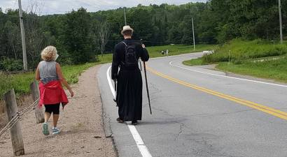 Fr. Scott and Sue Dagenais walk along Hwy. 32, a section of what was formerly the Opeongo Line.
